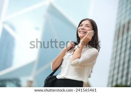 Business woman talking on smart phone in Hong Kong. Asian business people office worker talking on smartphone smiling happy. Young multiracial Chinese Asian / Caucasian female professional outside. - stock photo
