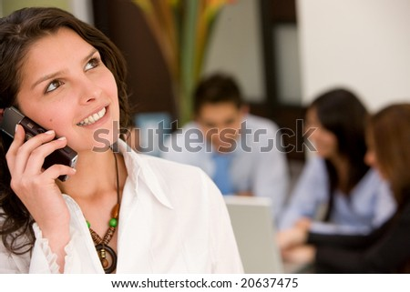 business woman talking on the phone in an office