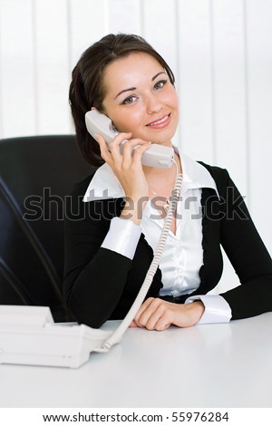 Business woman talking on the phone in office
