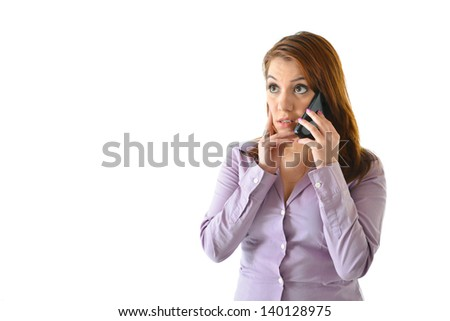 Business woman talking on the phone with concerned expression - stock photo