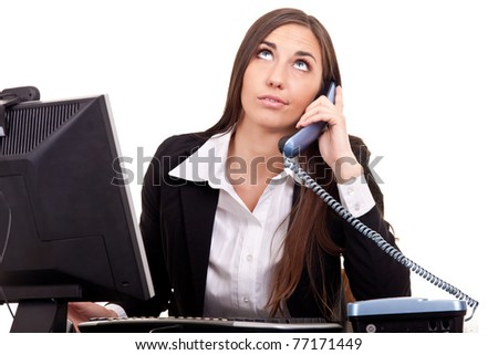 business woman talking with boring client on phone and working on  computer - stock photo