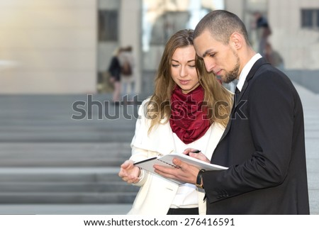 Business woman talks on the signing of the contract. Modern business partners having meeting. Business people. Business meeting. Meet the client. Business communication. Woman the focus of attention.  - stock photo