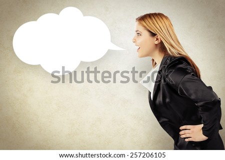 Business woman telling a message in speech balloon - stock photo