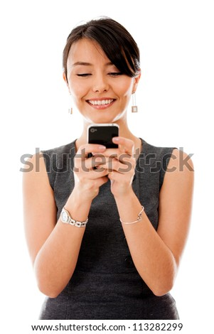 Business woman texting on her cell phone - isolated over a white background - stock photo