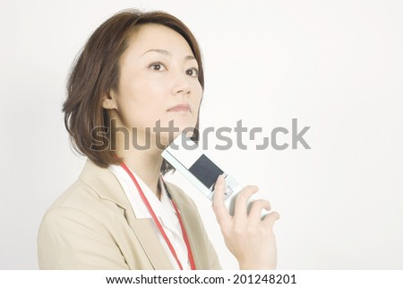 Business woman that the thinking has a mobile phone