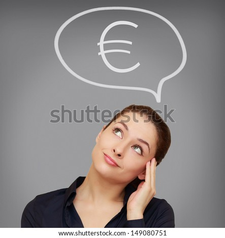 Business woman thinking about euro currency on grey background - stock photo