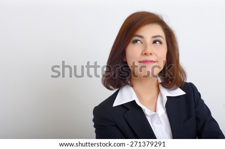 business woman thinking and looking up - stock photo