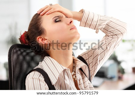 business woman tired depressed in office - stock photo