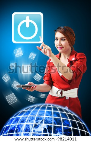 Business woman touch Power icon from mobile phone : Elements of this image furnished by NASA - stock photo