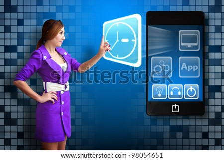 Business woman touch The Clock icon from mobile phone - stock photo