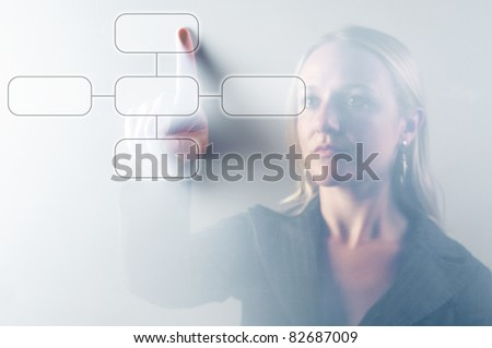 Business woman touching digital screen displaying a diagram - stock photo