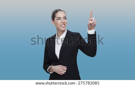 Business woman touching the screen with her finger on blue background - stock photo