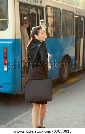 business woman traveling on public transport - stock photo
