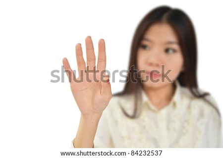Business woman try to touch something isolated on white background