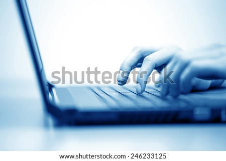 Business woman typing on keyboard. Shallow dof. - stock photo
