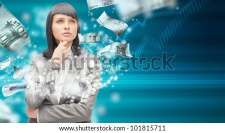 Business woman under a money rain - stock photo