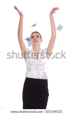 Business woman under a money rain - isolated over a white background