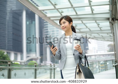 Business woman use of mobile phone - stock photo