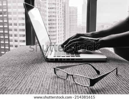Business woman using a laptop computer - stock photo