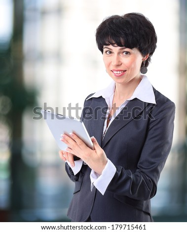 Business woman using electronic tab
