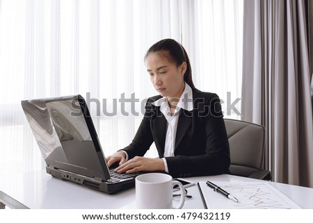 Business woman using laptop computer in office