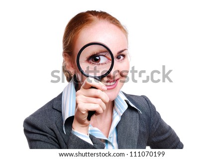 Business woman using magnifying glass - stock photo