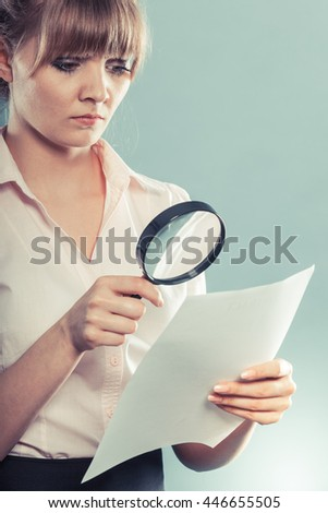 Business woman using magnifying glass to check contract instagram filter photo - stock photo