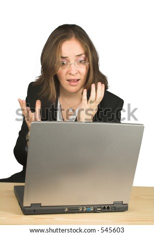 business woman very nervous looking at her computer - stock photo