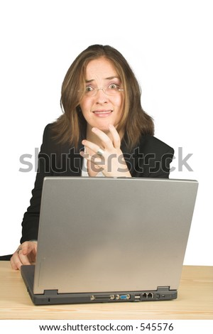 business woman very nervous on her computer - stock photo