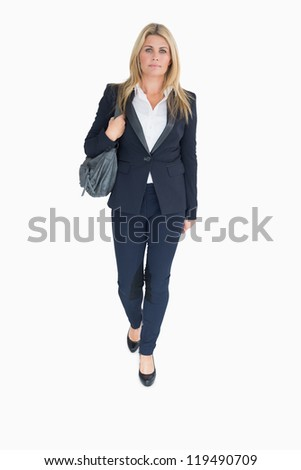 Business woman walking holding a handbag on the white background - stock photo