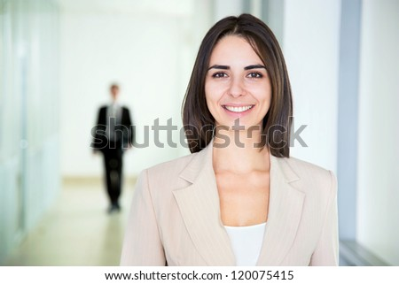 Business woman walking in the office corridor - stock photo