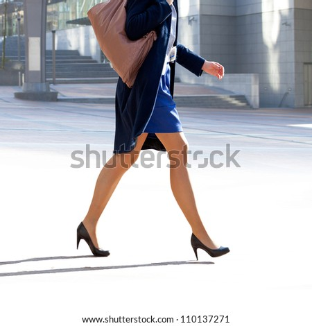 Business woman walking on the background of the office. The modern woman. - stock photo