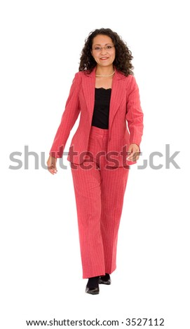 business woman walking towards the camera in a red suit - isolated over a white background - stock photo