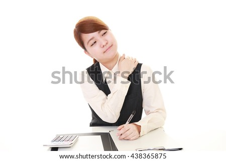 Business woman who has a shoulder pain. - stock photo