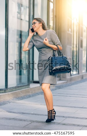 business woman with a beautiful smile, beautiful woman talking on the phone