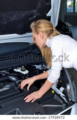 business woman with a car breakdown