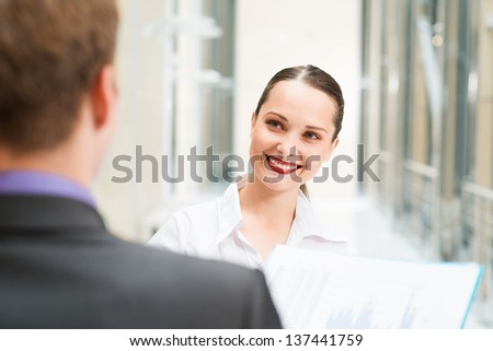business woman with a colleague discussing documents in the office