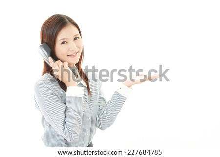 Business woman with a handset - stock photo