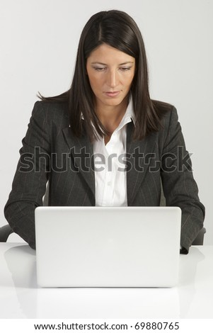 Business woman with a laptop - isolated over a white background - stock photo