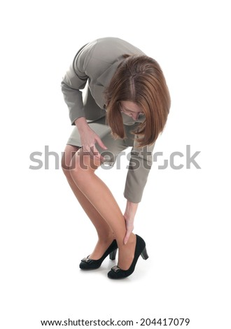 Business woman with a leg injury - stock photo
