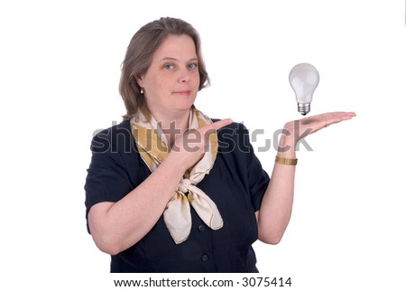business woman with a lightbulb in her open hand isolated on white - stock photo