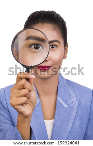 Business woman with a magnifier on white background.