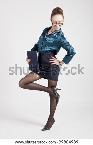business woman with a notebook on a white background in a short skirt - stock photo