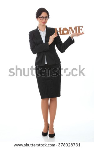 business woman with a wooden sign with the words home