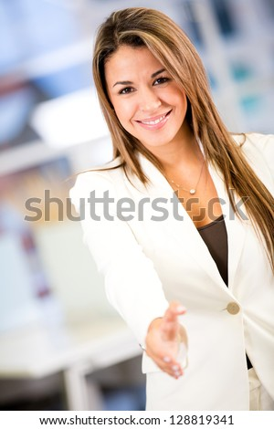 Business woman with arm extended to handshake - stock photo