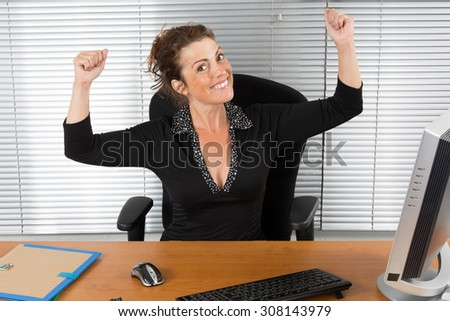 Business woman with arms up