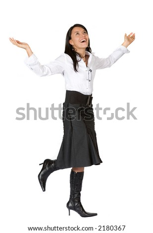 business woman with arms up looking very happy - stock photo