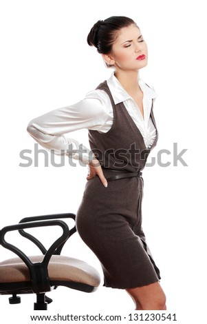 Business woman with back pain after long work on chair. Isolated on white background - stock photo