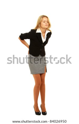 Business woman with back pain holding her aching hip - stock photo