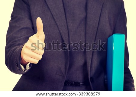 Business woman with binder showing thumbs up. - stock photo